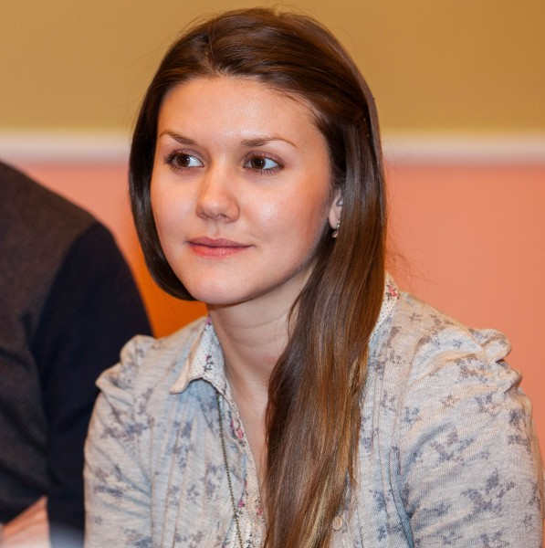 a young brunette Catholic woman photographed in December 2013, picture 10/11