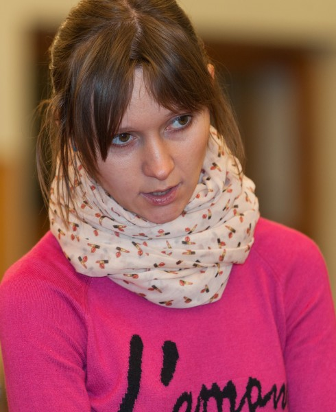 a young brunette woman photographed in a church in December 2014