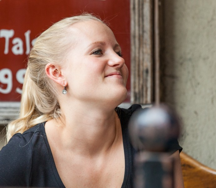 a young pretty blond woman photographed in Stockholm, Sweden in June 2014, picture 6/8