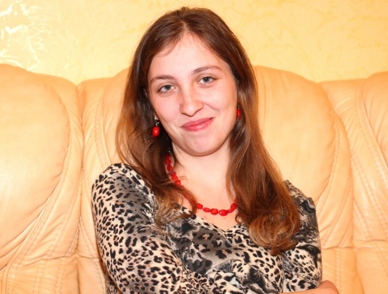 a beautiful smiling charming young brunette Catholic woman, picture 25