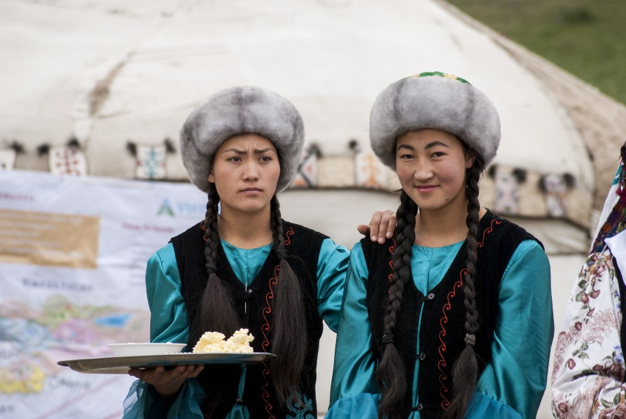 Kyrgyz women offering butter and salt