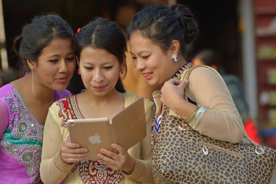 Nepali women with iPad