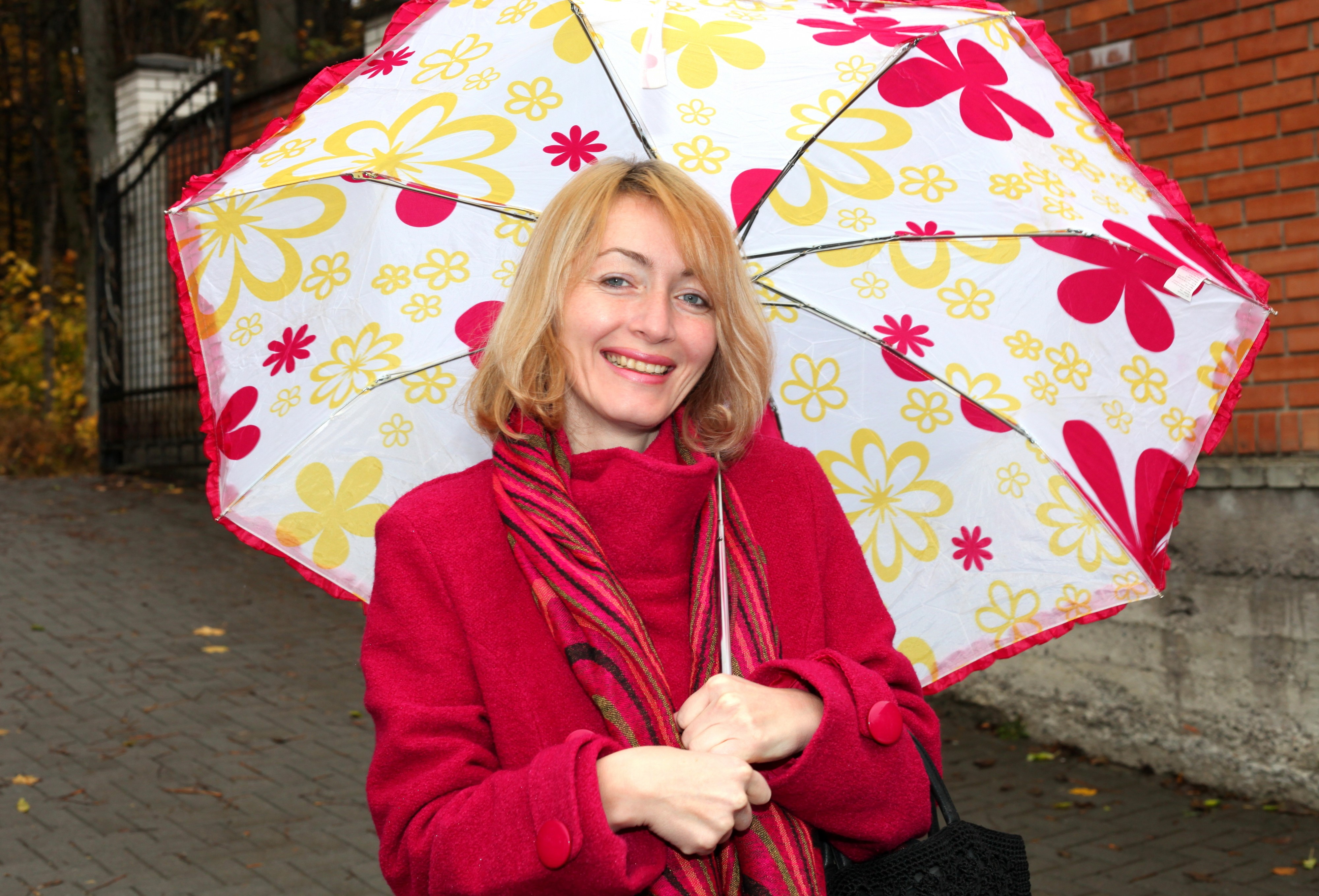 a beautiful Catholic woman with an umbrella, picture 1