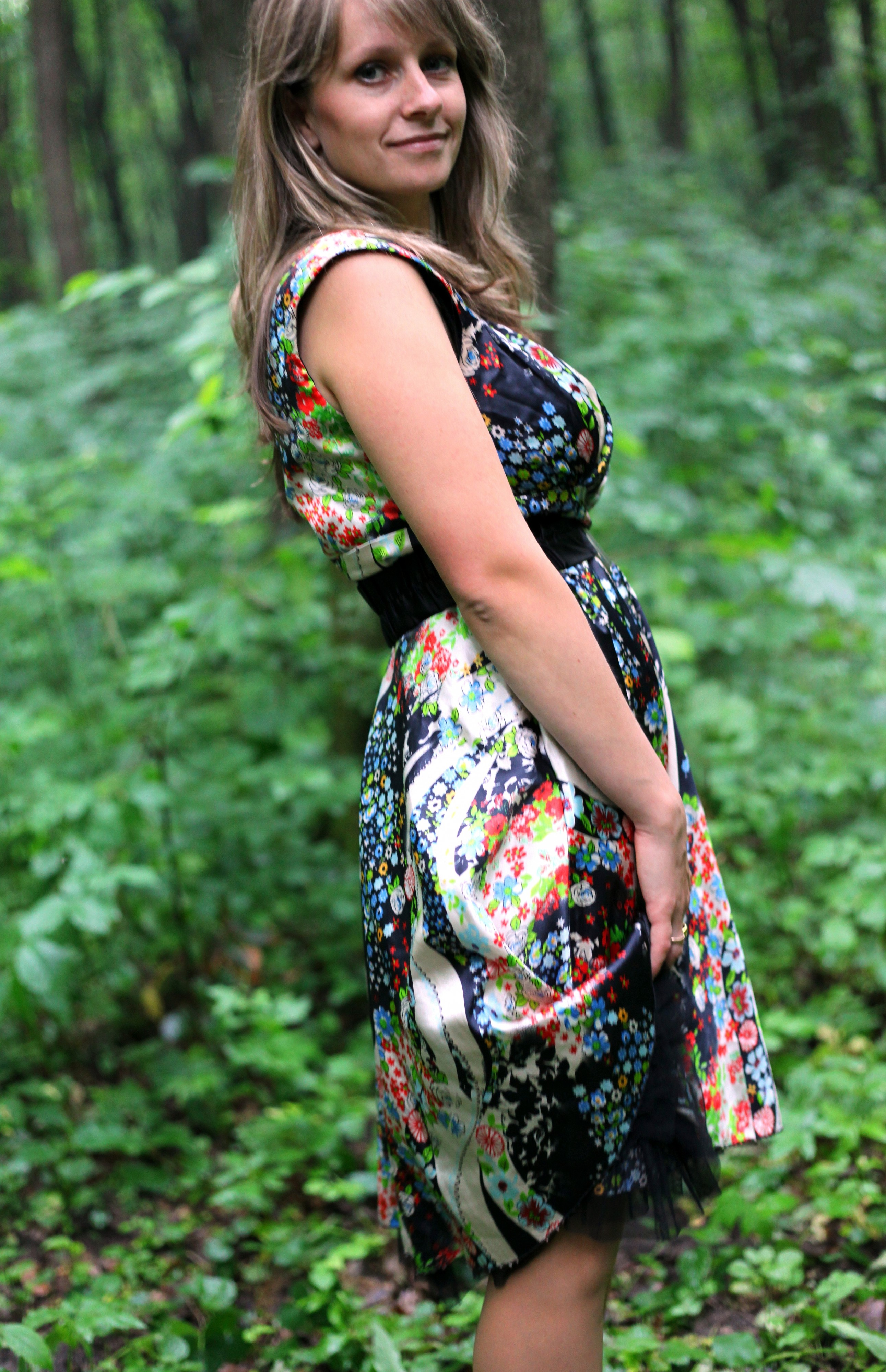 a young Catholic woman wearing a colorful dress in a forest in June 2013, portrait 9/9