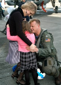 US Navy 050301-N-3770P-001 An air crew member greets his loved ones after returning from a deployment to the Western Pacific Ocean aboard USS Abraham Lincoln (CVN 72)