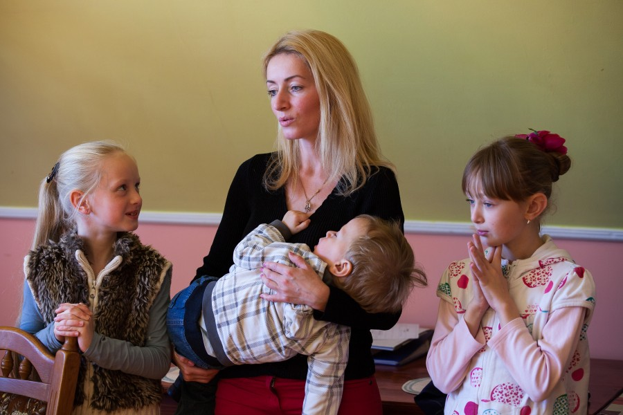 a young Catholic mother with her three children photographed in October 2013