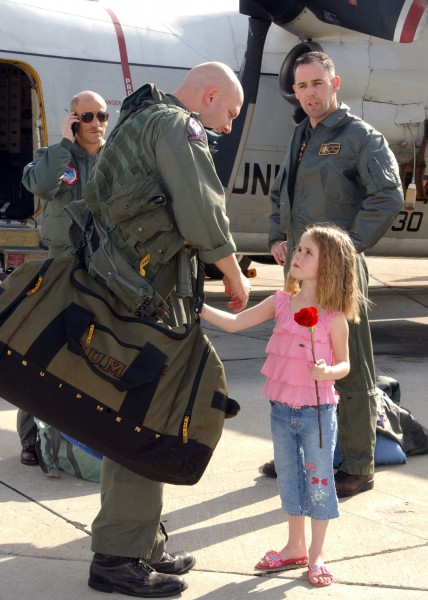 US Navy 050228-N-7615S-019 Lt. Cmdr. Chris Marlar reunites with his daughter after returning home to San Diego, Calif., from deployment