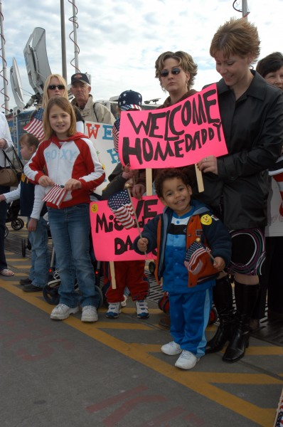 US Navy 050304-N-3390M-410 Hundreds of friends and family gather at the pier on board Naval Station Everett, Wash., to welcome home their loved ones from a deployment to the Western Pacific Ocean aboard the Nimitz-class aircraf