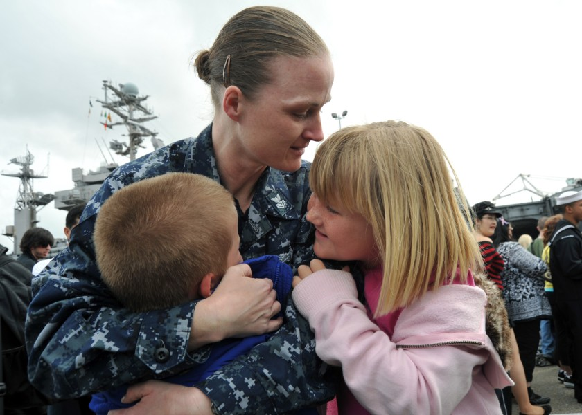 US Navy 110319-N-YB753-170 Mass Communication Specialist 1st Class Sarah Murphy embraces her children upon return from a deployment aboard the airc