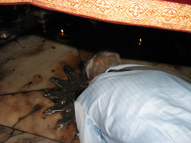 A pilgrim is kissing the place where the Savior - Messiah - was born in the Church of Nativity, Bethlehem, Palestinian Territories, picture 5.