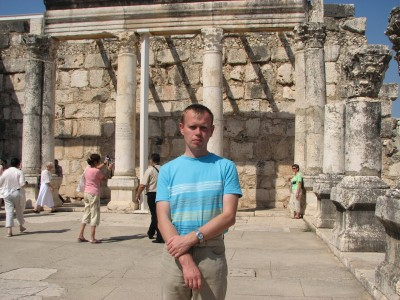 A Catholic pilgrim man in the ruins of Capharnaum, Israel, picture 2