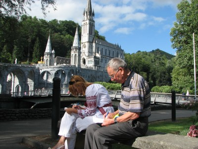 A young woman and an old man in Lourdes, France, 2010.