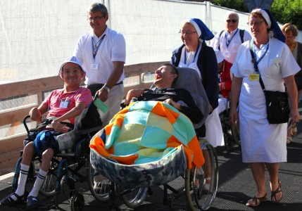people on wheelchairs in Lourdes, France, August 2013, picture 10