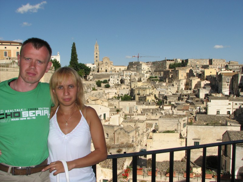 A young couple (celebrating their 10-th anniversary of being married) in Matera town, southern Italy, European Union, summer 2011