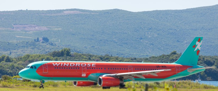 a Windrose airplane photographed in Tivat, Montenegro in August 2014, picture 6