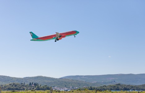 a WIndrose airplane departing Tivat, Montenegro in August 2014, picture 7