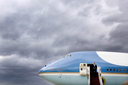 Barack Obama disembarks from Air Force One under a storm sky