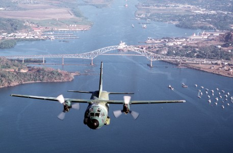 C-27A Spartan over bridge and water