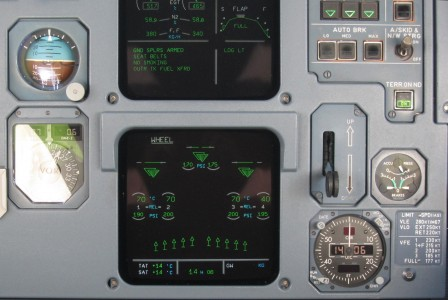 Center panel display indicating spoilers deployment in A320 cockpit