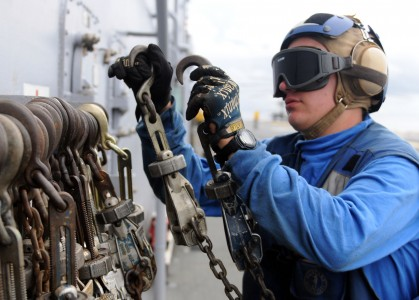 Defense.gov News Photo 100913-N-5538K-213 - U.S. Navy Airman Recruit Jeremy J. New stows tie-down chains after removing them from a CH-46E Sea Knight helicopter aboard the USS Essex LHD 2 in
