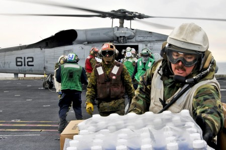 Defense.gov News Photo 110319-N-DM338-068 - U.S. sailors and Marines aboard the aircraft carrier USS Ronald Reagan load humanitarian assistance supplies onto an HH-60H Seahawk helicopter