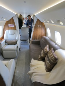 Embraer Legacy 650 interior of aft cabin with passengers