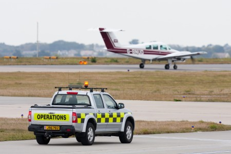 Jersey Airport operations vehicle and aircraft