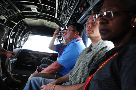 Members of the Marine Corps Executive Forum (MCEF) ride in a Marine Corps CH-46 Sea Knight helicopter as it flies over the National Capital Region, July 8, 2011 110708-M-KS211-108