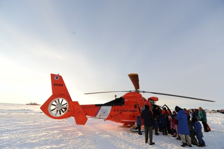 Nome, Alaska, residents surround a U.S. Coast Guard MH-65 Dolphin helicopter in Nome Jan 120118-G-YE680-083