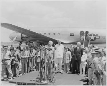 Photograph of President Truman speaking at the airport ceremony marking the departure of Secretary of State James... - NARA - 199409