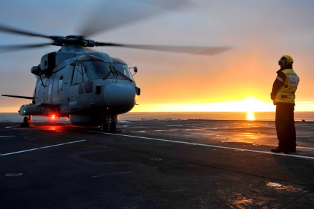 Royal Navy Merlin Helicopter Prepares to Takeoff from RFA Argus MOD 45153599