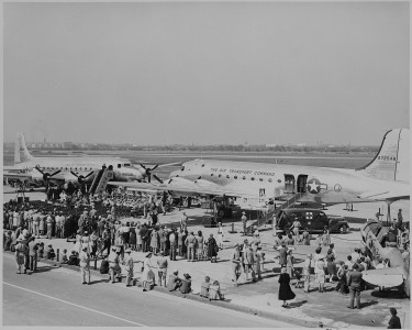 Two airplanes and a crowd gathered for the christening by Bess Truman of the airplanes. - NARA - 199098