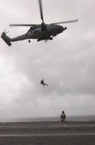 US Navy 030824-N-6536T-003 Personnel from the Explosive Ordnance Disposal Mobile Unit Eleven Detachment One (EOD MU-1 DET 1), practice exiting out of an SH-60 Seahawk helicopter