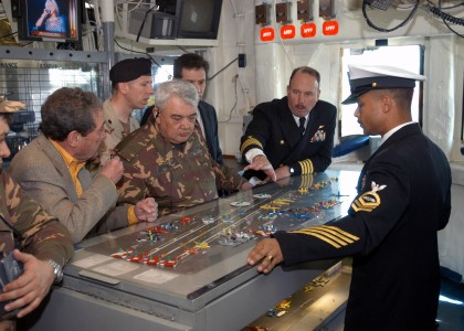 US Navy 040326-N-6187M-001 Captain E. C. Neidlinger, Commanding Officer, USS Enterprise (CVN 65) (right), briefs visiting dignitary General-Major Ismail Ergashev on flight deck operations