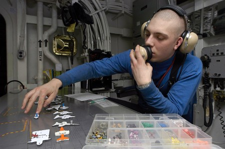 US Navy 040407-N-9630B-042 Airman Garrett Tober, of Sacramento, Calif., checks the spotting of all aircraft in the hangar bay, in hangar deck control aboard USS George Washington (CVN 73)
