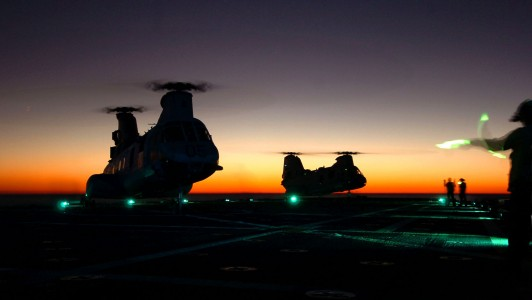US Navy 061029-N-4236E-001 Two CH-46 Sea Knights land on the flight deck during night operations aboard the amphibious transport dock USS Shreveport (LPD 12)