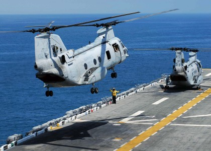US Navy 090720-N-8607R-024 A CH-46E Sea Knight prepares to land on the flight deck of the amphibious assault ship USS Bonhomme Richard (LHD 6)