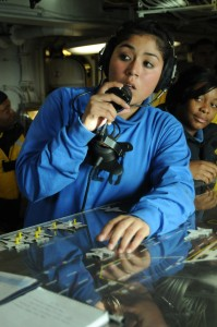 US Navy 091210-N-0808V-031 Aviation Boatswain's Mate (Handling) Airman Jessica Rocha communicates on a sound powered telephone in flight deck control aboard USS Carl Vinson (CVN 70)