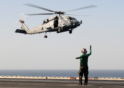 US Navy 100216-N-4236E-032 A Sailor directs the landing of an HH-60H Sea Hawk helicopter assigned to the Nightdippers of Helicopter Anti-Submarine Squadron (HS) 5