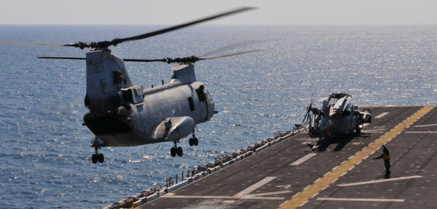 US Navy 110329-N-5538K-217 A CH-46E Sea Knight helicopter carrying humanitarian assistance supplies takes off from the forward-deployed amphibious