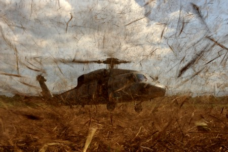 US Navy HH-60 picks up military personnel in Haiti