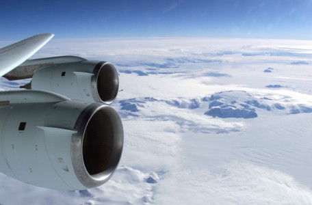 View over an DC-8 wing with CFM-56 engines to antarctica