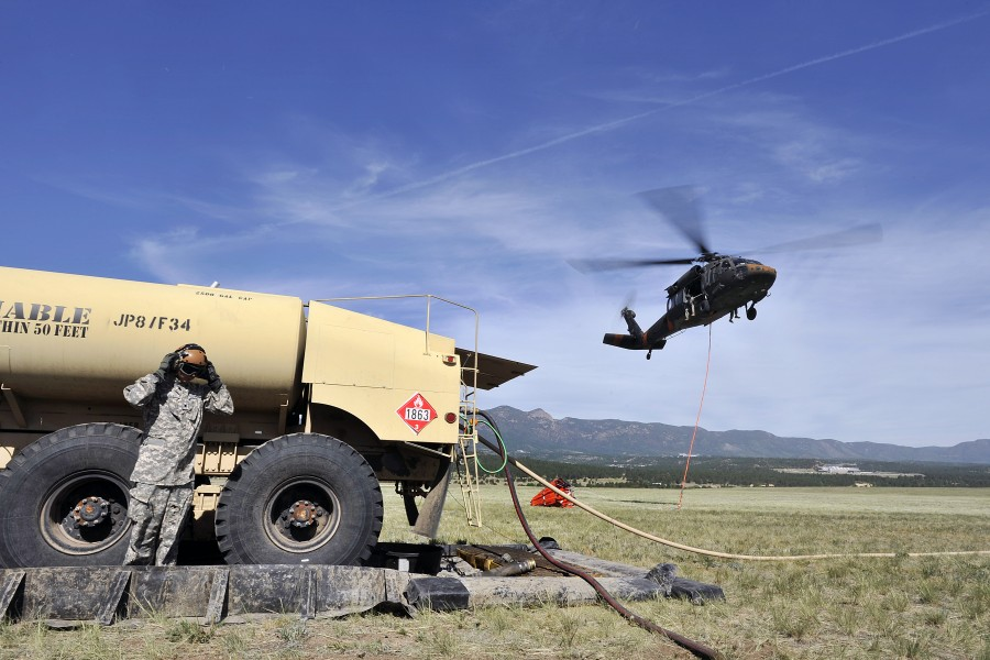 A U.S. Army UH-60 Black Hawk helicopter with the Colorado Army National Guard leaves a refueling point to fight a wildfire near Colorado Springs, Colo., June 12, 2013 130612-F-JM997-878