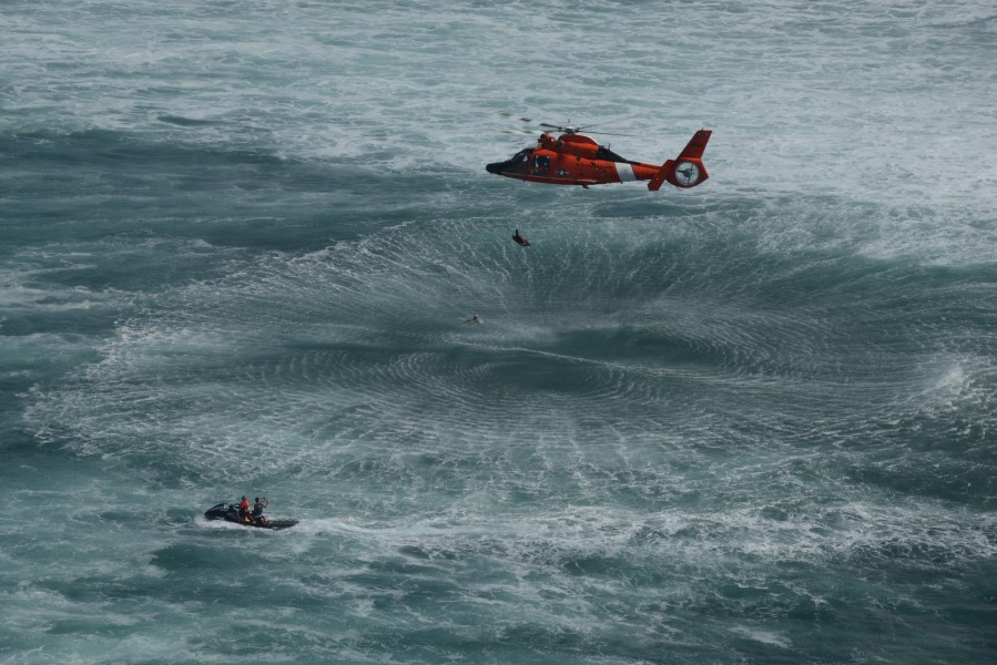 A U.S. Coast Guard MH-65 Dolphin helicopter with Air Station Barbers Point practices surf search and rescue techniques in Haleiwa, Hawaii, Jan. 18, 2013 130118-G-ZQ587-002