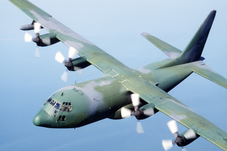 An air-to-air left front view of a 95th Tactical Airlift Squadron C-130 Hercules aircraft DF-ST-89-04148