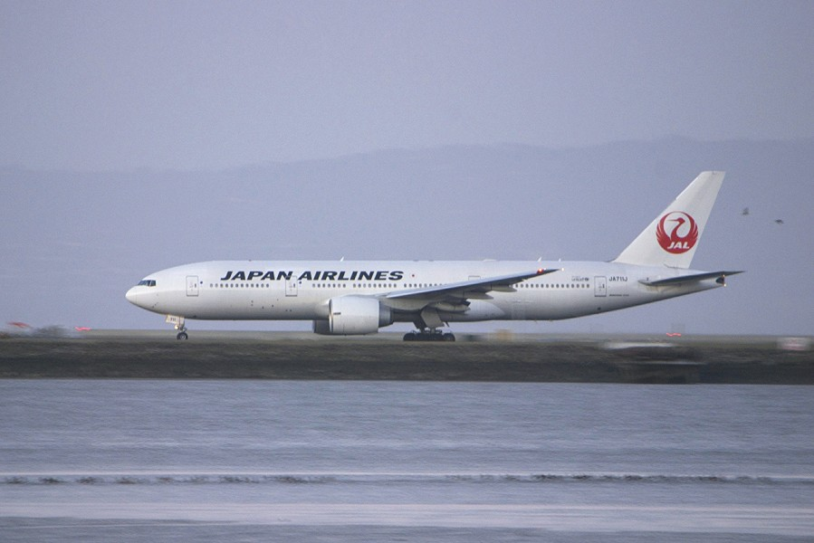 Boeing 777-200 JAL accelerating... passing birds... thank you, Nikon! (8500306928)