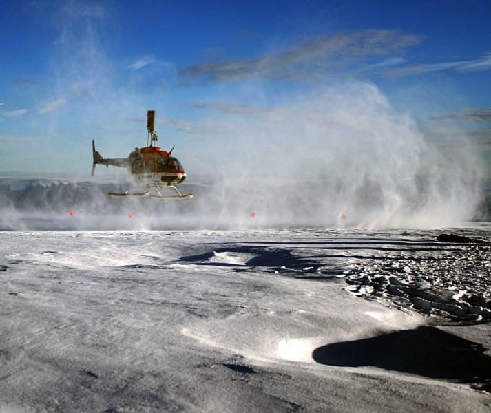 Helicopter is taking off Greenland ice sheet
