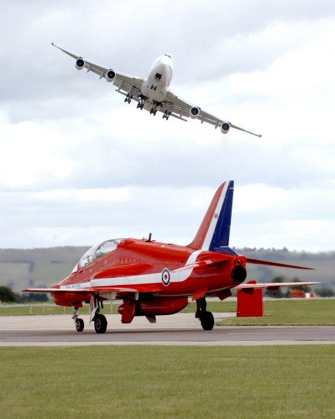 On Boeing 747 Swoops Over a Royal Air Force Red Arrow at Air Show MOD 45145189