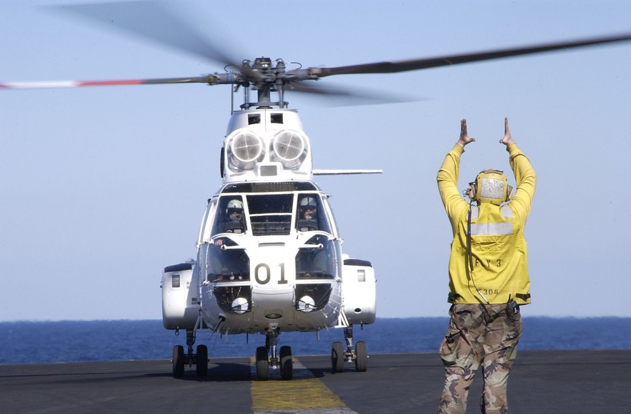 US Navy 030326-N-4308O-015 An SA-332 Super Puma helicopter is given the signal to lift off of the flightdeck of USS Harry S. Truman (CVN 75