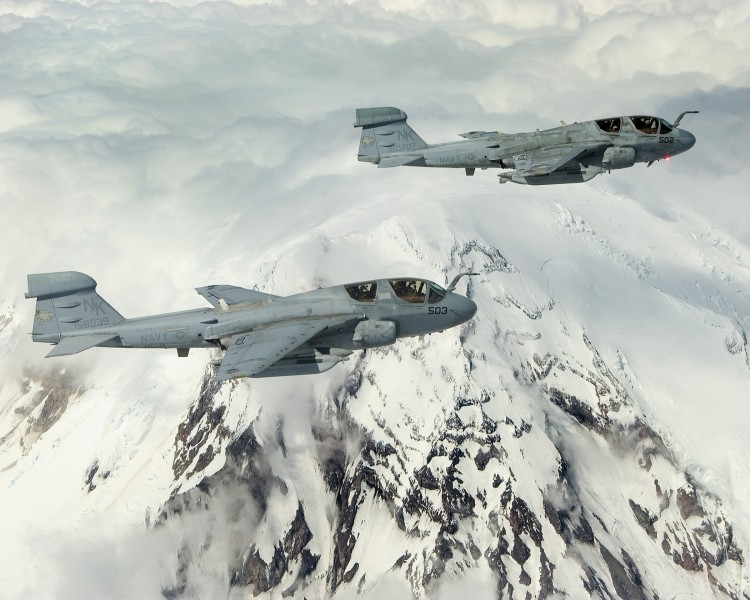 US Navy 040519-N-6436W-006 Two EA-6B Prowlers assigned to the Cougars of Electronic Attack Squadron One Three Nine (VAQ-139) fly in formation around Washington's Mount Rainier